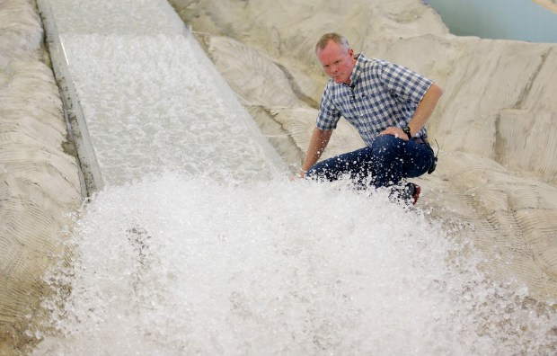 Michael Johnson with a replica of the Oroville Dam spillway. (AP Photo/Rick Bowmer)
