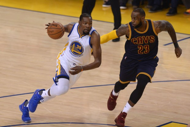 The Golden State Warriors' Kevin Durant (35) drives on the Cleveland Cavaliers' LeBron James (23) the first quarter of Game 1 of The Finals at Oracle Arena in Oakland, Calif., on Thursday, June 1, 2017. (Dan Honda/Bay Area News Group)
