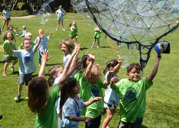 """Kids jump for bubbles during a Marinwood summer camp at the Marinwood Community Center in San Rafael, Calif. on Wednesday, June 14, 2017. """"Bubblesmith"""" Sterling Johnson provided the bubble show for the 4 to 6-year-old day campers. (Alan Dep/Marin Independent Journal)"""