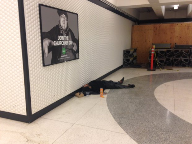 A person sleeps in the Powell Street BART Station in San Francisco on May 17,. 2017. A BART spokesperson says cleaning up after homeless people in stations adds to the work of janitors and the overtime they work. Thomas Peele photoSent from my iPhone