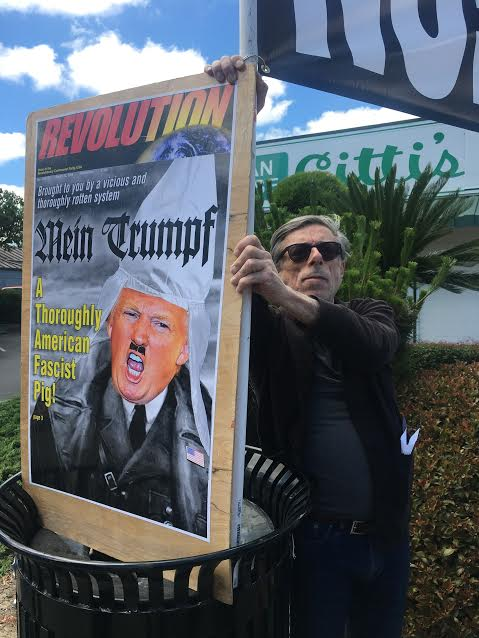 San Jose resident Curt Wechsler holds a sign opposing Trump on Saturday, June 10