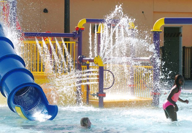Kids enjoy the water toys at the Robert Livermore Aquatic Center in Livermore. (Gina Halferty/staff file)
