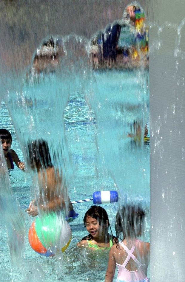 Kids play in the pool at the El Cerrito Swim Center. (Gregory Urquiaga/staff file)
