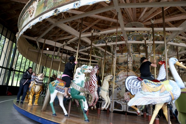 Visitors ride the carousel inside Golden Gate Park in San Francisco, Calif., on Tuesday, June 6, 2017. The carousel was built by the Herschell-Spillman Company in 1914 and ran continuously until 1977, when it broke down. The ride was repaired, restored and reopened to the public in 1984. (Anda Chu/Bay Area News Group)