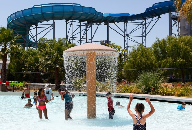 Kids stay cool at Boomerang Bay at California's Great America in Santa Clara, California, on Thursday, June 22, 2017. Temperatures are expected to hit triple digits as California's most severe heatwave in a decade peaks today. (Gary Reyes/ Bay Area News Group)