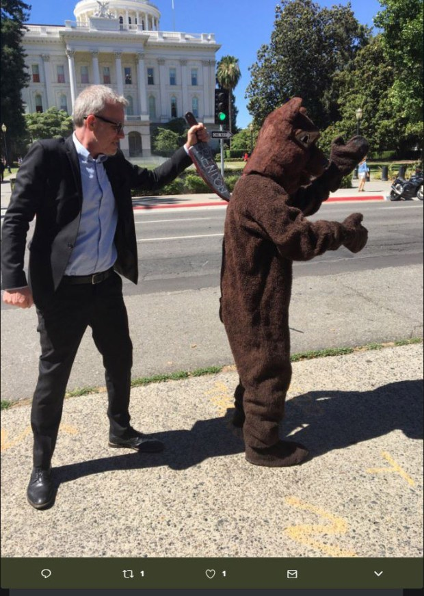 "A demonstrator at a Wednesday single-payer health care rally at the Capitol does an enactment of a new internet meme of a California bear being stabbed in the back by Assembly Speaker Anthony Rendon, D-Paramount. Rendon on Friday blocked a $400 billion single-payer health care proposal from advancing in the Assembly, saying it was ""woefully incomplete"" without a funding source. The photo was posted on Twitter and later taken down. (Courtesy Twitter)"