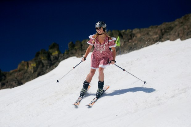 "Santa Clara University student Miranda Dunne, 20, skis down the slopes of the ""Gold Coast Face"" run at Squaw Valley in Lake Tahoe, California on Sunday, June 25, 2017. Thanks to abundant winter snow, Squaw Valley's management announced the ski resort's upper ski runs will remain open past July 4 indefinitely for the first time in the history of the ski resort. (Josie Lepe/Bay Area News Group)"