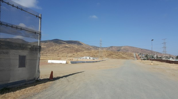 Basic surveying and leveling work is in progress along the U.S./Mexico border as depicted in this photo made in June 2017 in California, near San Diego. The work is in advance of construction of prototypes for the border wall promised by Donald Trump. (Courtesy Jill Marie Holslin)