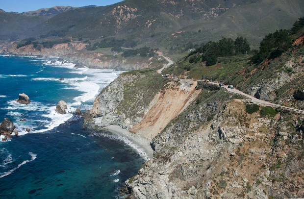 The view looking north over the landslide blocking Highway 1 south of Rocky Creek Bridge as California Highway Patrol fly their helicopter in Big Sur, Calif. on Thursday March 31, 2011. (Photo By David Royal/ Monterey County Herald)