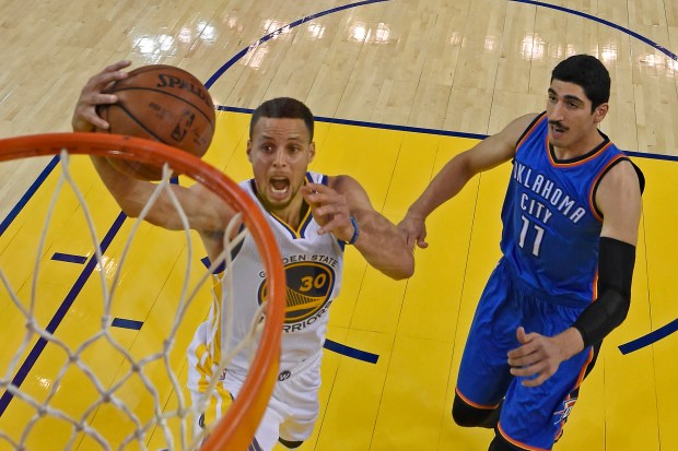 Golden State Warriors' Stephen Curry (30) goes up for a layup past Oklahoma City Thunder's Enes Kanter (11) in the first half of Game 1 of the NBA Western Conference finals at Oracle Arena in Oakland, Calif., on Monday, May 16, 2016. Oklahoma City defeated Golden State 108-102. (Jose Carlos Fajardo/Bay Area News Group)
