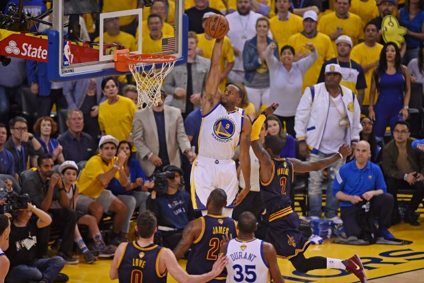 Golden State Warriors' Andre Iguodala (9) goes up for a dunk past Cleveland Cavaliers' Kyrie Irving (2) during the first quarter of Game 1 of the NBA Finals at Oracle Arena in Oakland, Calif., on Thursday, June 1, 2017. (Jose Carlos Fajardo/Bay Area News Group)