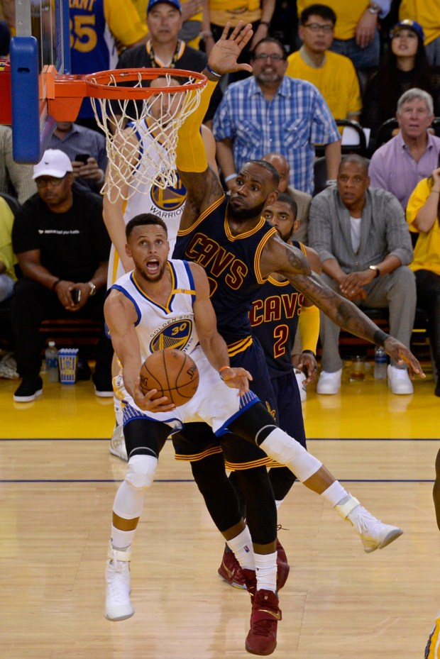 Golden State Warriors' Stephen Curry (30) goes for a basket past Cleveland Cavaliers' LeBron James (23) during the third quarter of Game 1 of the NBA Finals at Oracle Arena in Oakland, Calif., on Thursday, June 1, 2017. The Golden State Warriors defeated the Cleveland Cavaliers 113-91. (Jose Carlos Fajardo/Bay Area News Group)