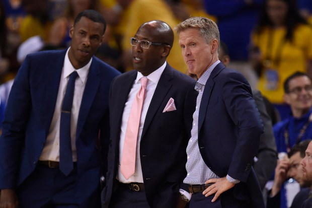 Golden State Warriors assistant coach Mike Brown talks to head coach Steve Kerr during a timeout against the Cleveland Cavaliers during the first quarter of Game 2 of the NBA Finals at Oracle Arena in Oakland, Calif., on Sunday, June 4, 2017. (Jose Carlos Fajardo/Bay Area News Group)