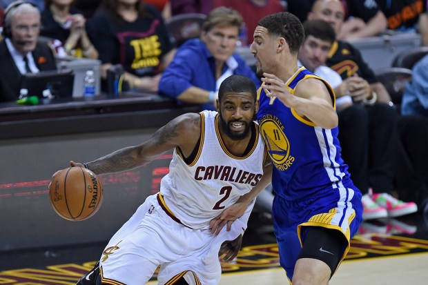Golden State Warriors' Klay Thompson (11) guards Cleveland Cavaliers' Kyrie Irving (2) as he drives to the basket during the first quarter of Game 3 of the NBA Finals at Quicken Loans Arena in Cleveland, Ohio, on Wednesday, June 7, 2017. (Jose Carlos Fajardo/Bay Area News Group)