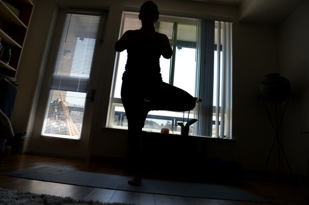 "Rocsana Enriquez does yoga in her Daly City, Calif., apartment on Friday, Jan. 23, 2017. Enriquez, who is very familiar with the juvenile justice system from her youth, is looking to use ""trama-informed yoga"" as a way to help young girls in the juvenile justice system rehabilitate and reclaim their lives. (Dan Honda/Bay Area News Group)"