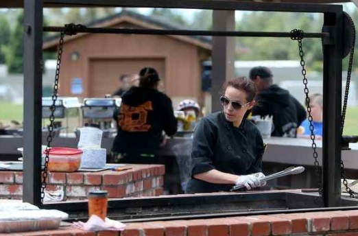 Private chef Julie Levinson prepares tri-tip for highway workers at Skypark in Scotts Valley on Sunday. (Kevin Johnson -- Santa Cruz Sentinel)