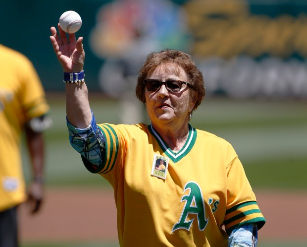 Helen Hunter throws the ceremonial first pitch in honor of her deceased husband, Catfish Hunter, at Oakland Coliseum Saturday, June 17, 2017, in Oakland, Calif. (Jim Gensheimer/Bay Area News Group)