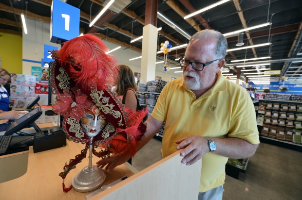 David Groves, of Walnut Creek, makes a purchase on the first day of business at the new Goodwill store in Walnut Creek, Calif. on Wednesday, July 12, 2017. (Kristopher Skinner/Bay Area News Group)