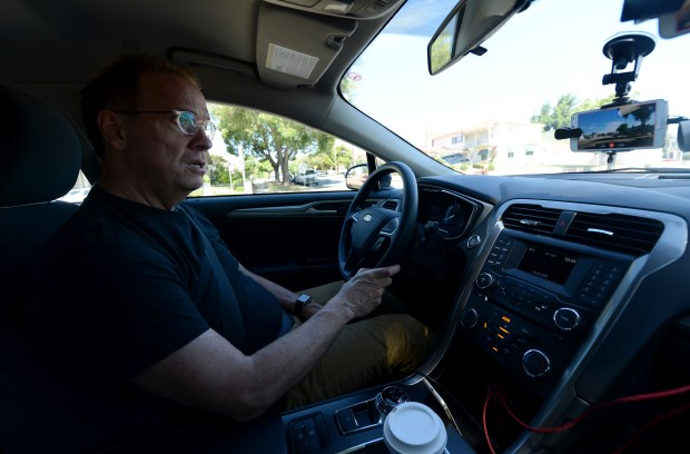 "RoadBotics CEO Mark DeSantis, drives the streets of Pittsburg, Calif., on Friday, July 14, 2017. DeSantis is using his companies ""smart"" technology that allows your smart phone's video camera to gather data on the condition of the road it is recording in order to create a detailed map showing the damage level of the roads and streets being recorded. (Dan Honda/Bay Area News Group)"