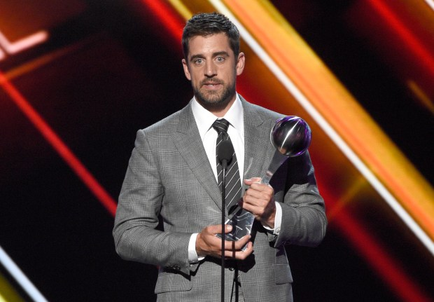 NFL football player Aaron Rodgers, of the Green Bay Packers, accepts the award for best play at the ESPYS at the Microsoft Theater on Wednesday, July 12, 2017, in Los Angeles. (Photo by Chris Pizzello/Invision/AP)
