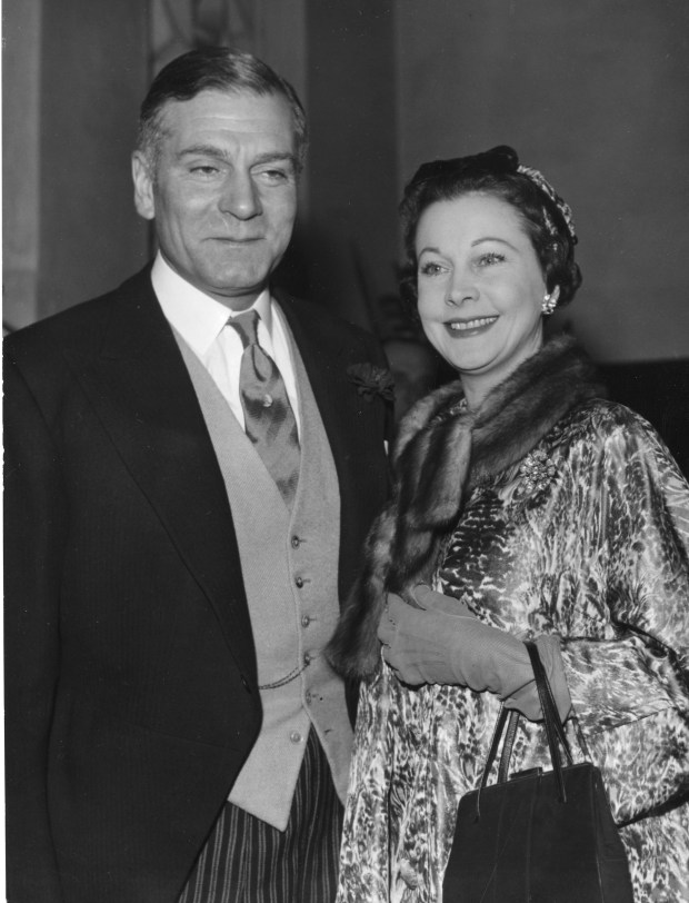Indian born, British actress Vivien Leigh arrives with her husband actor Sir Laurence Olivier, at the Holy Trinity church in London, England, December 6, 1957, to attend the wedding of Suzanne Holman, Miss Leigh's daughter by her first marriage to Robin Farrington, member of Lloyd's underwriting firm. Miss Holeman's father, Leigh Holman, gave the bride away. (AP Photo)