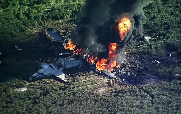 The military plane that crashed in a farm field, in Itta Bena, Miss. (WLBT-TV via AP)