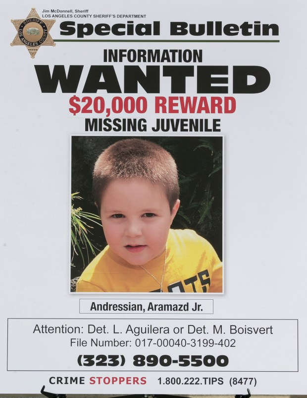 A poster of Aramazd Andressian Jr., a 5-year-old boy who had been missing for several weeks from South Pasadena, Calif.(AP Photo/Damian Dovarganes)