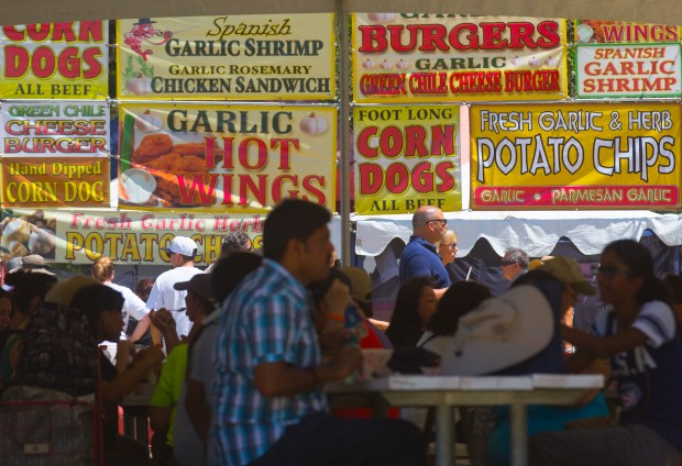 """A variety of garlic-flavored foods were offered during the 38th annual Gilroy Garlic Festival on Friday, July 29, 2016 in Gilroy, Calif. The massive event, which continues 10am to 7pm Saturday and Sunday, is expected to draw over 100,000 visitors for a buffet of garlicky activities and food. Garlic fans can expect the usual """"Pyro Chef"""" displays in Gourmet Alley, cook-offs, arts and crafts and famous free garlic ice cream. A highlight this year: past festival presidents and legendary cooking duo Gene Sakahara and Sam Bozzo, made their last cooking appearance after 25 years of cook-off events. (Patrick Tehan/Bay Area News Group)"""