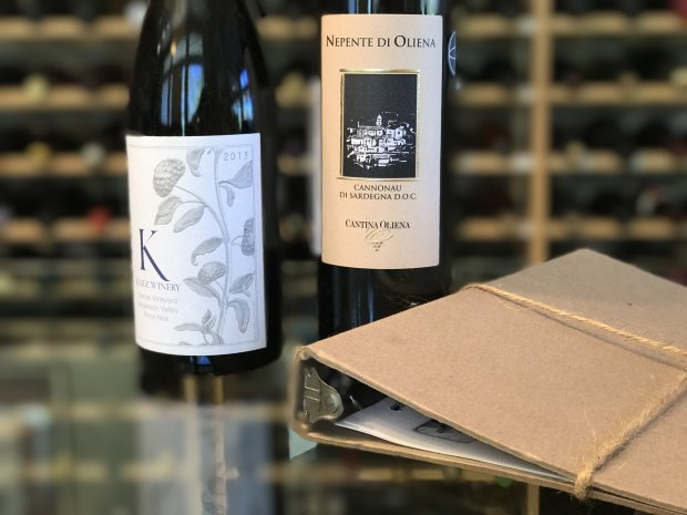 From The Panel wine club shipment, a Mendocino pinot noir and Sardiniancannonau and a binder with wine descriptions and tasting notes. (Mary Orlin/Bay Area News Group)