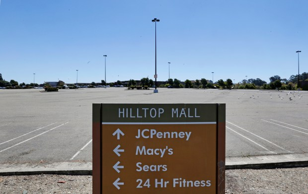 A small percentage of the parking lot is being used at Hilltop Mall in Richmond, Calif., on Thursday, July 20, 2017. While some indoor malls are booming, like Valley Fair in San Jose, many are struggling. (Laura A. Oda/Bay Area News Group)