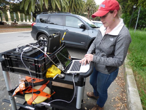 Eileen Martin, a Stanford Ph.D. student in computational and mathematicalengineering, is working on an experiment in which her team sets off tiny controlled explosions and then records them using a fiber optic cable network beneath the ground. (Photo by Jean Martin)