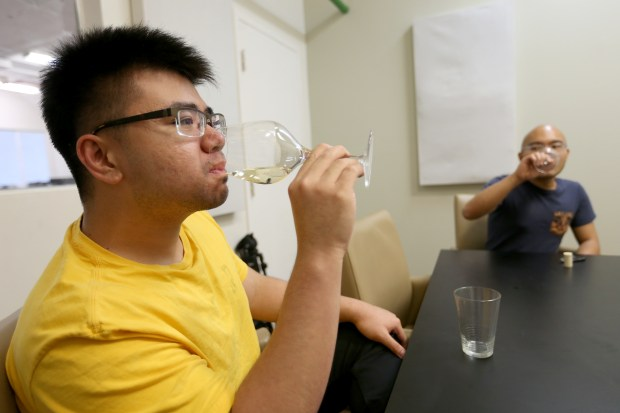 Ava Winery co-founders Mardonn Chua and Josh Decolongon, from left, sample a sparkling Moscato wine at their new location on Illinois Avenue in San Francisco, Calif., on Tuesday, July 25, 2017. Alec Lee (not pictured) is the third co-founder of the startup has begun to engineer synthetic wine without using grapes. (Jane Tyska/Bay Area News Group)