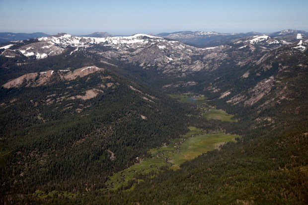 A scenic expanse of the Sierra Nevada known as the Lower Carpenter Valley, shows off it's vibrant meadows, forests and wetlands, Monday, July 10, 2017, in an aerial photograph taken north of Truckee, California. Once owned as a fishing retreat by newspaper publisher Jim McClatchy and two of his friends, the land was preserved from development under a $10 million deal with the Northern Sierra Partnership, the Nature Conservancy and the Truckee Donner Land Trust. (Karl Mondon/Bay Area News Group)