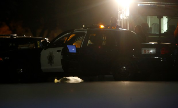 "San Jose police investigate an officer-involved shooting on Kirkhaven Court on Aug. 17, 2015. Richard ""Harpo"" Jacquez was shot and killed after being pursued by officers looking to arrest him in connection with a deadly shooting a few days earlier. (Nhat V. Meyer/Bay Area News Group)"