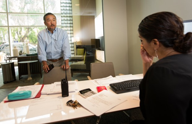 Mike Kim, of SF-based Simeon Residential Properties, talks with business manager, Hope Reed, as he does his weekly walk-through inspection at Centerra, a luxury tower in downtown San Jose, California, Thursday, July 27, 2017. His company is the owner/developer. (Patrick Tehan/Bay Area News Group)
