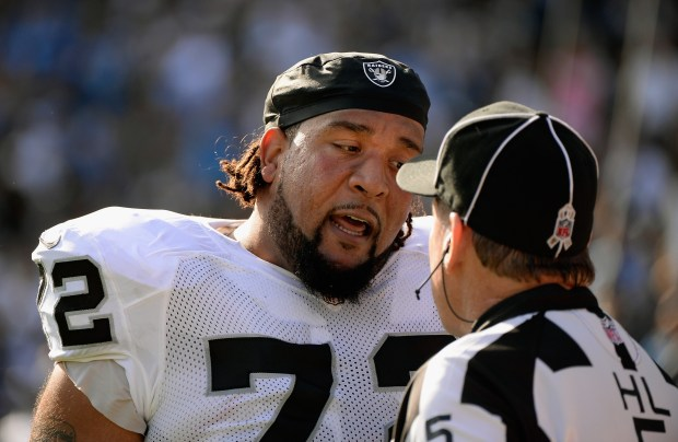 SAN DIEGO, CA - NOVEMBER 16: Donald Penn #72 of the Oakland Raiders talks to the head linesman John McGrath #5 after a play in the first quater against the San Diego Chargers at Qualcomm Stadium on November 16, 2014 in San Diego, California. (Photo by Harry How/Getty Images)