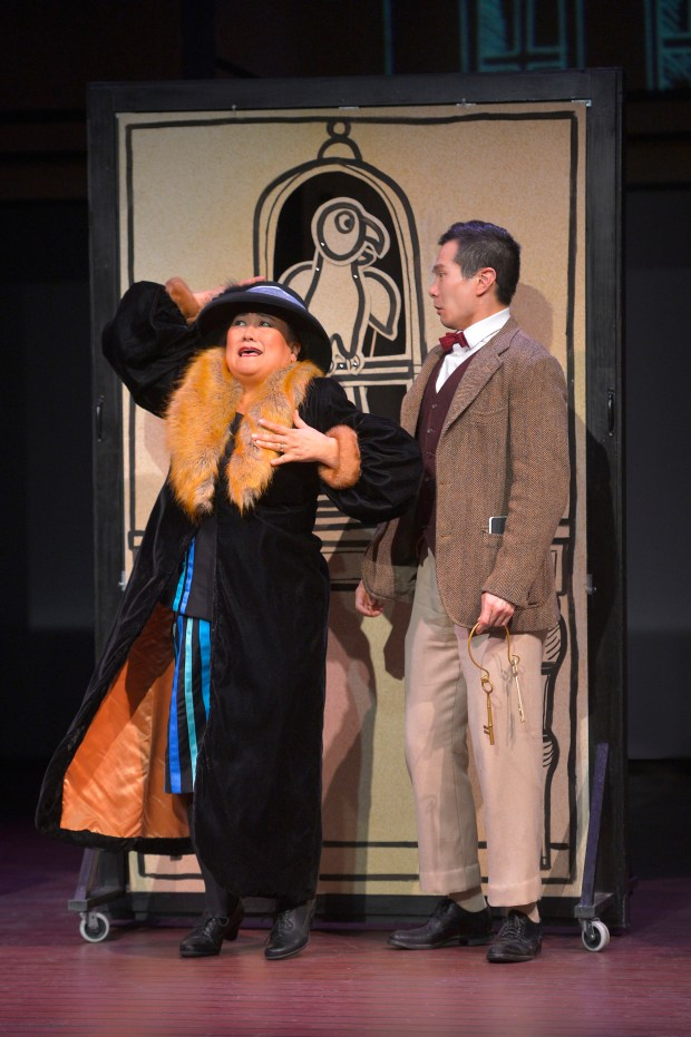 """Henry's employer (Kerry Keiko Carnahan), left, is shocked to hear what Henry (James Seol) has done after asking him to watch her parrot in Min Kahng's """"The Four Immigrants: An American Musical Manga,"""" presented by TheatreWorks Silicon Valley at the Lucie Stern Theatre in Palo Alto, ,July 12 through Aug. 16, 2017. (Kevin Berne / TheatreWorks Silicon Valley)"""