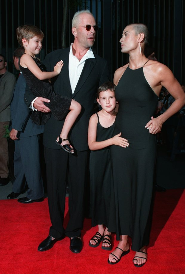 "Actress Demi Moore, right, accompanied by husband Bruce Willis, and their children, Scout, left, and Rumer, center, arrive at the premiere of ""Striptease,"" at the Ziegfeld Theatre in New York Sunday June 23, 1996. Moore stars in the film which was directed by Andrew Bergman and produced by Mike Lobell. (AP Photo/Albert Ferreira)"