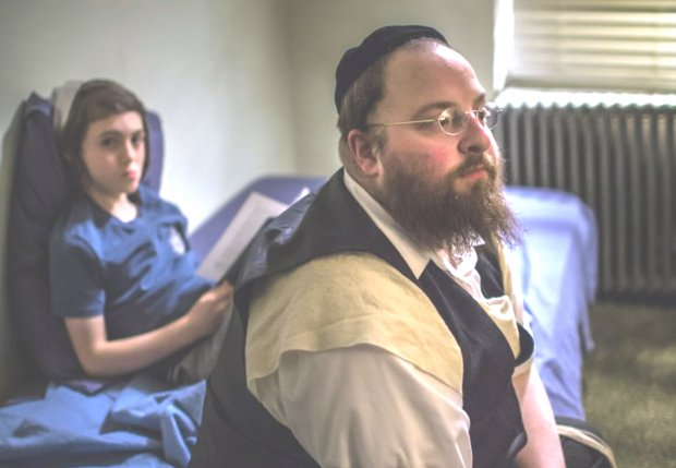 Ruben Niborski, left, plays Rieven, and Menashe Lustig plays his father,Menashe. (A24)