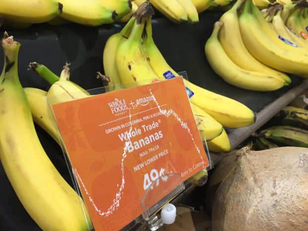 At a Whole Foods store in Walnut Creek on Monday, Aug. 28, 2017, bananas were marked down to 49 cents per pound from 79 cents per pound, a discount that Whole Foods touted was a result of its purchase by Amazon. Amazon has promised to lower prices to make shopping at Whole Foods more affordable.