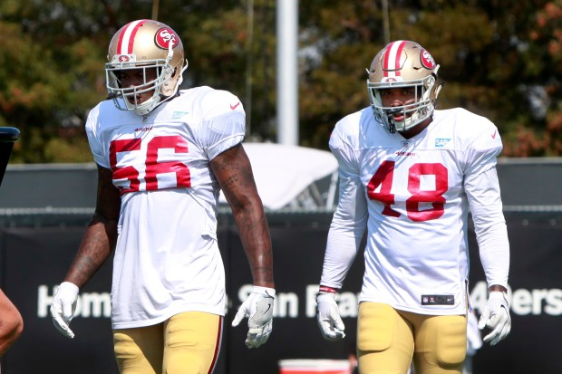 San Francisco 49er linebacker Donavin Newsom (48) lines up behind teammate Reuben Foster (56) during training camp, Wednesday, Aug. 2, 2017, in Santa Clara, California. Newsom was injured at camp Tuesday and was taken away by ambulance. (Karl Mondon/Bay Area News Group)