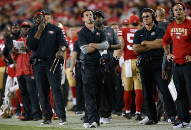 San Francisco 49ers head coach Kyle Shanahan looks at the replay of a touchdown by Denver Broncos running back Juwan Thompson (40) in the fourth quarter at Levi's Stadium on Saturday, Aug. 19, 2017, in Santa Clara, Calif. (Jim Gensheimer/Bay Area News Group)