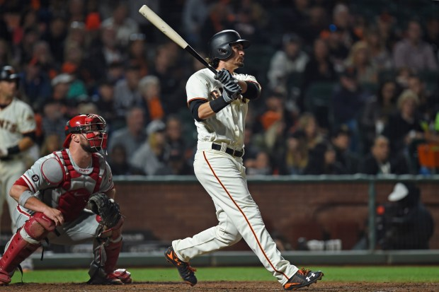San Francisco Giants' Jarrett Parker (6) connects for a double that scores teammates Denard Span (2) and Hunter Pence (8) against the Philadelphia Phillies in the fifth inning of their MLB game at AT&T Park in San Francisco, Calif. on Thursday, Aug. 17, 2017. (Jose Carlos Fajardo/Bay Area News Group)