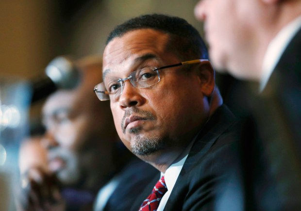 "CORRECTS TO REMOVE REFERENCE THAT ELLISON REPRESENTS BLOOMINGTON - FILE - In this Dec. 2, 2016, file photo, U.S. Rep. Keith Ellison, D-Minn., listens during a forum on the future of the Democratic Party in Denver. Ellison issued a statement Wednesday, Aug. 9, 2017, through the national party calling it ""an outrage"" that President Donald Trump hasn't condemned the bombing of a Bloomington mosque on Saturday, Aug. 5. Ellison is the nation's first Muslim elected to Congress. (AP Photo/David Zalubowski, File)"