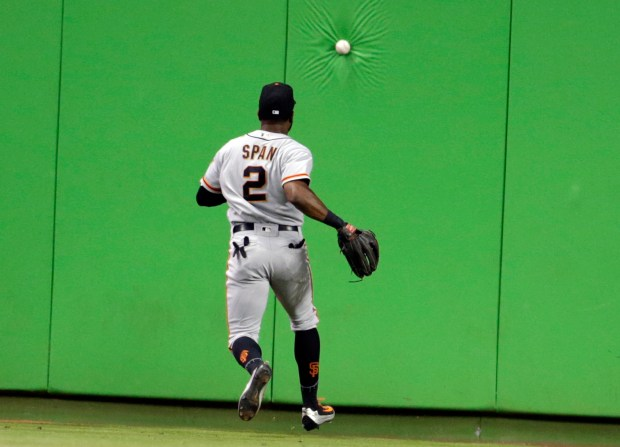 San Francisco Giants center fielder Denard Span (2) chases down a ball hit by Miami Marlins' Christian Yelich for a double during the first inning of a baseball game, Tuesday, Aug. 15, 2017, in Miami. (AP Photo/Lynne Sladky)