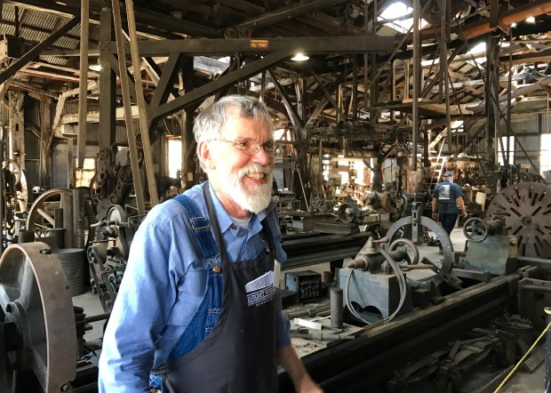 It's easy to spot members of the Knight Foundry Alliance, the docentsworking to restore Sutter Creek's Gold Rush-era foundry, by their distinctive aprons. The foundry aprons and other merchandise help raise funds for the restoration project. (Photo: Jackie Burrell/Bay Area News Group)