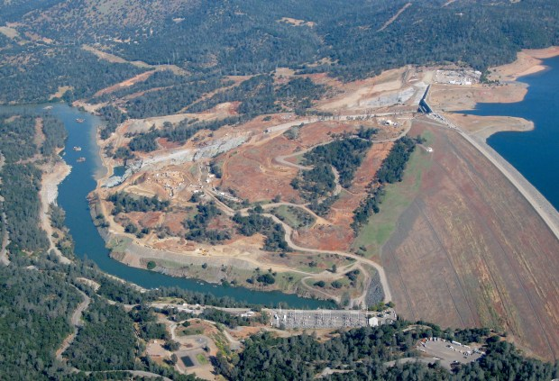 Oroville Dam and damaged control Spillway are seen during a flight over the area with Oroville pilot Gonzalo Pee Wee Curiel Friday May 26, 2017. (Bill Husa -- Enterprise-Record)