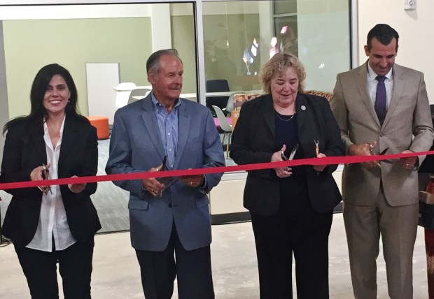 From left, San Jose Vice Mayor Magdalena Carrasco, John A. Sobrato, U.S. Rep. Zoe Lofgren and San Jose Mayor Sam Liccardo help cut the ribbon on Downtown College Prep's new campus in the old Southern Lumber building on Monterey Highway on Friday, Aug. 25, 2017. (Sal Pizarro/Staff)