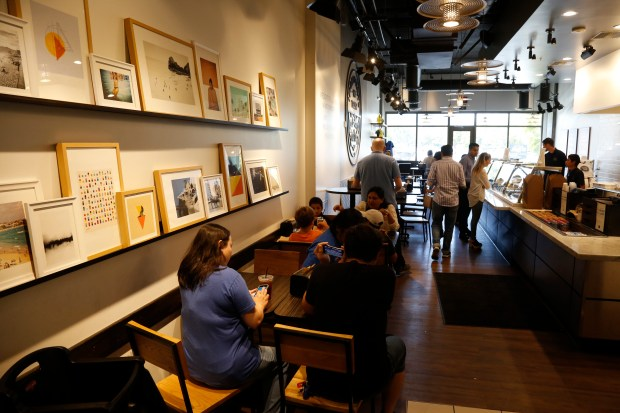 Pizza Studio features an eclectic decor in Mountain View, California, Friday, Aug. 25, 2017. Los Angeles-based Pizza Studio launched in 2012 and now has more than 100 locations across the country. (Patrick Tehan/Bay Area News Group)