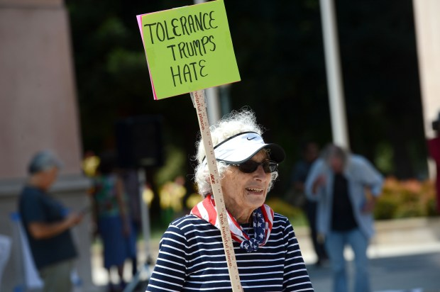 "Stella Karras, of Cupertino, came in the name of herself, her daughter and her grandchildren, to a rally against white supremacy and other forms of discrimination, in response to the recent events in Charlottesville, in Mountain View, Calif., on Saturday, Aug. 19, 2017. The rally was originally organized in response to a now-postponed right-wing ""March on Google"" protest against Google over the firing of an engineer over an internal memo regarding women. This rally also called for peaceful protests to bring about change. (Dan Honda/Bay Area News Group)"